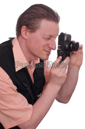 photographer looking through a camera