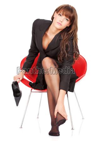 woman give herself foot massage
