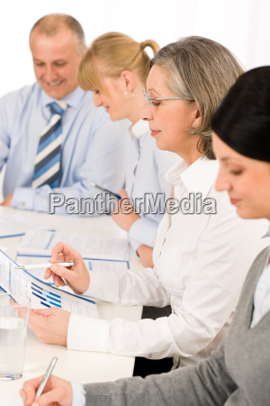 business meeting team examining sales report