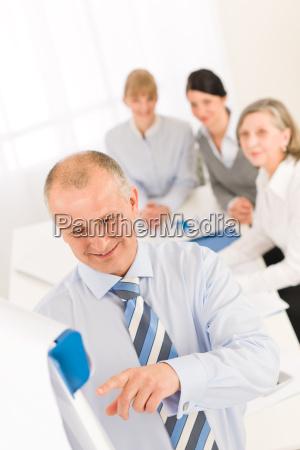 giving presentation businessman point flip chart