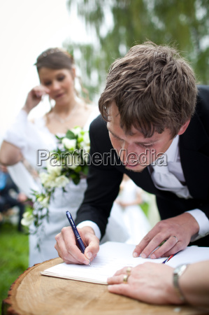 young wedding couple posing outdoors