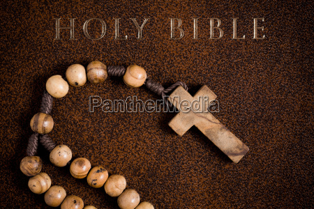 wooden rosary on the bible