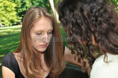 friends one teenage girl comforts