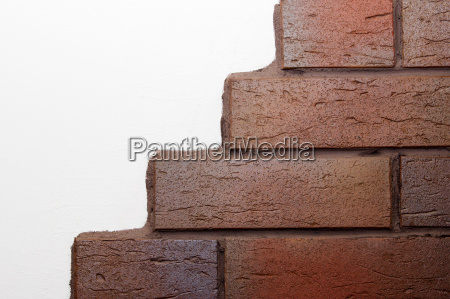 white wall with clinker bricks