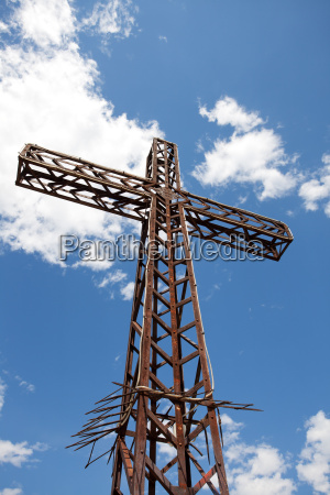metal cross on a sunny day