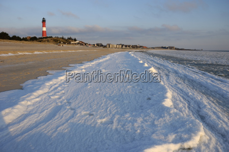 frozen surf on the beach of