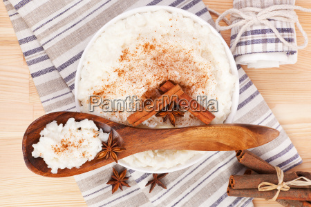 rice pudding with wooden spoon