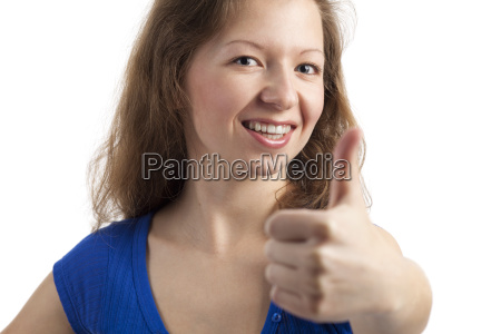 friendly smiling young woman with thumbs