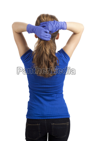 standing woman binds the hair with