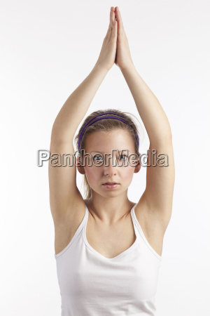 young woman with arms facing upwards