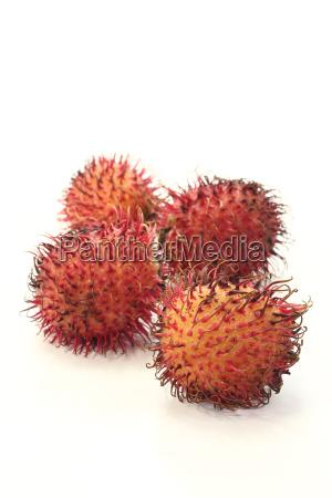 four fresh rambutan
