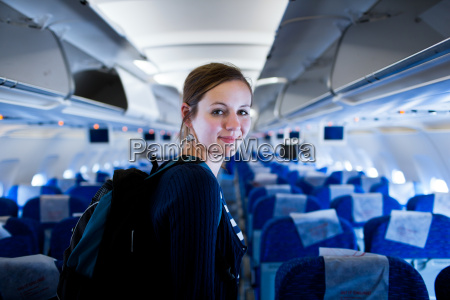 pretty young female passenger on board