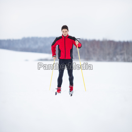 young man cross country skiing