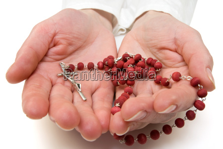 rosary in the woman hands