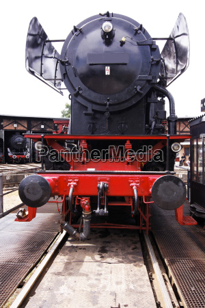 roundhouse with steam locomotives