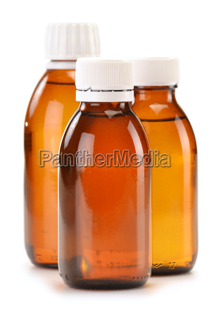 bottles of syrup medication on white