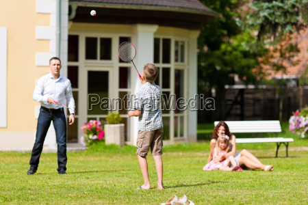 family playing in the summer before