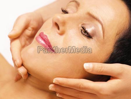 woman gets facial massage