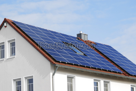modern house roof with solar panels