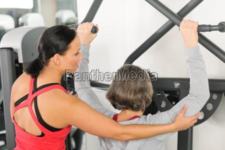 fitness center trainer senior woman exercise