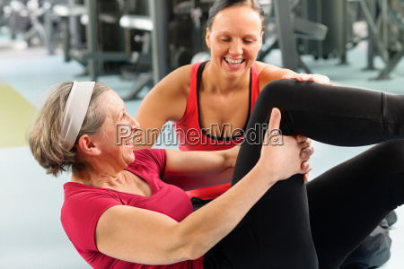 fitness center senior woman exercise gym