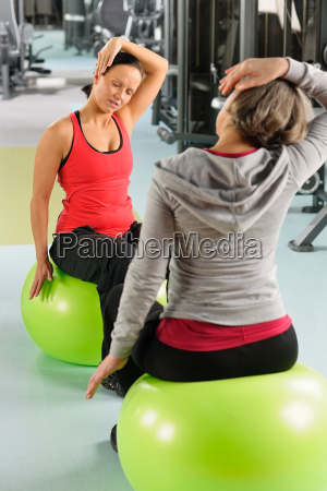 senior woman with trainer stretching fitness