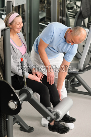 physiotherapist assist active senior woman at