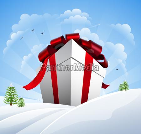 huge christmas present in snow