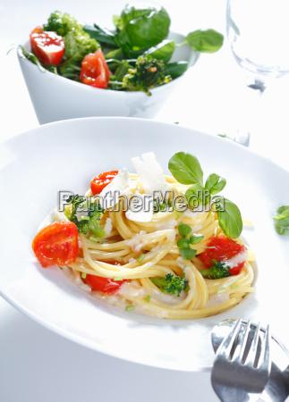 a plate of spaghetti broccoli