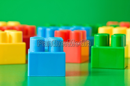 colorful blocks on green background