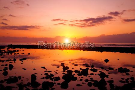 sunset beach and rocks