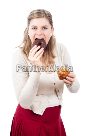 woman eating chocolate donut and sweet