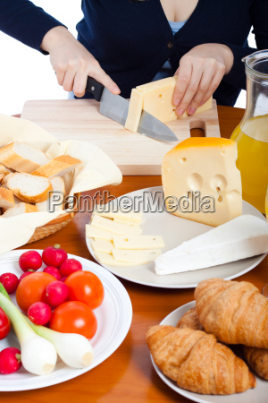 cutting emmenthal cheese