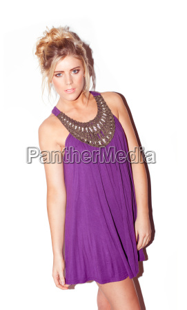 attractive blonde in purple dress