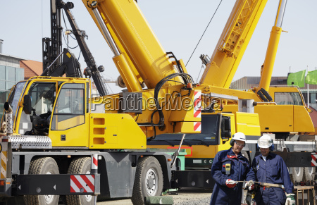 mobile cranes and workers