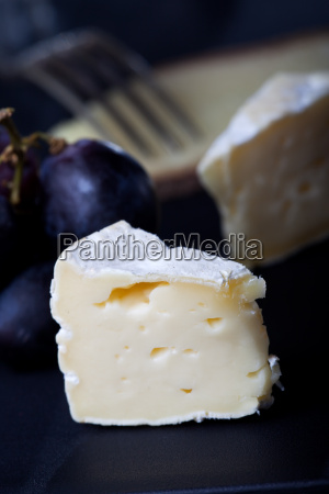 swiss cheese with grapes and wine