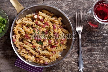 ham noodles in a copper pan