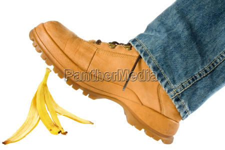 man stepping on banana peel