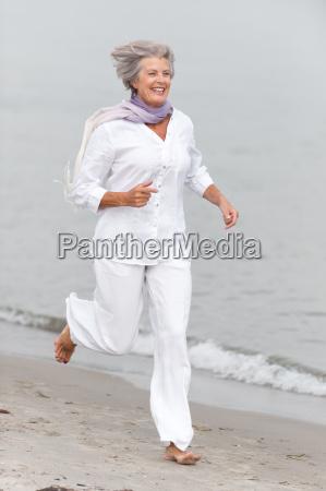 active senior on the beach