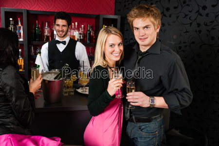 couple at cocktail bar drink champagne