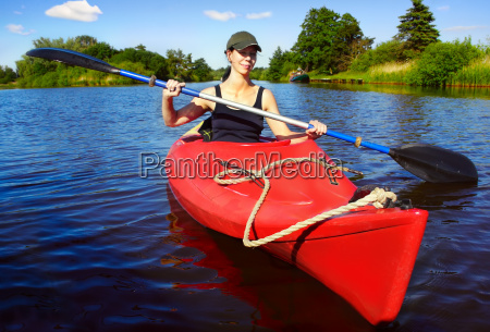 woman in paddle boat on a