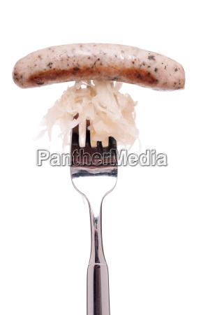 nuremberg bratwurst with sauerkraut and fork
