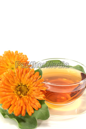 marigold tea with flowers and leaves