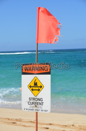 strong current warning sign and flag