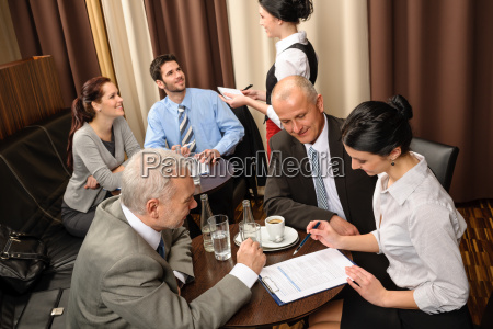 business meeting executives dealing at restaurant
