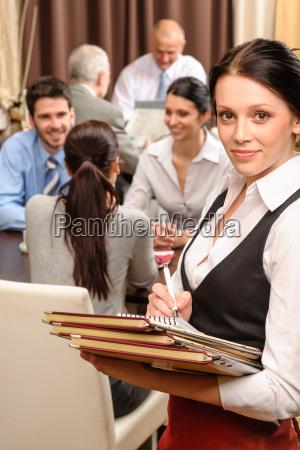 waitress hold menu business people at