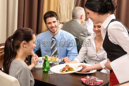 business lunch restaurant waitress serving woman