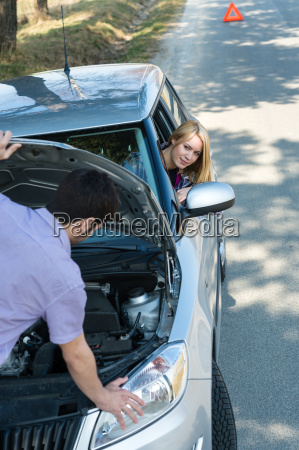 car troubles couple starting broken vehicle