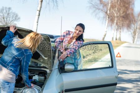 starting broken car two women have
