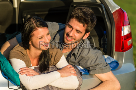 camping young couple lying car summer